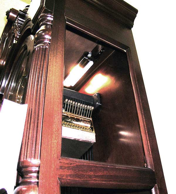 Looking upward in the right hand access panel, you may see how the lamp in fastened to the inside of the grandfather clock.