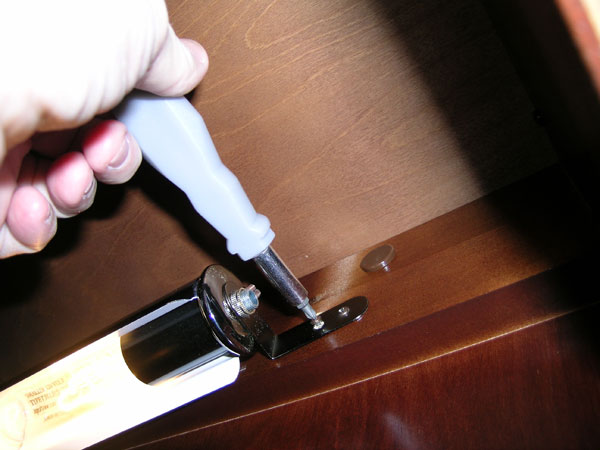 removing the screws on the grandfather clock lamp